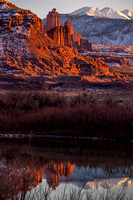 Fisher Towers Reflects on the Colorado River on a January Evening